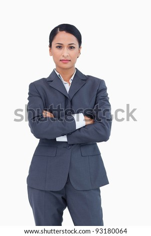 Serious businesswoman with folded arms against a white background - stock photo