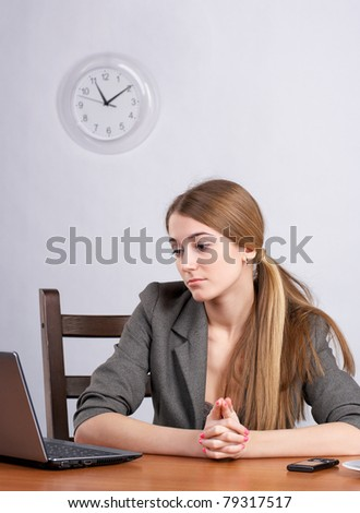 Serious businesswoman working on laptop at office - stock photo