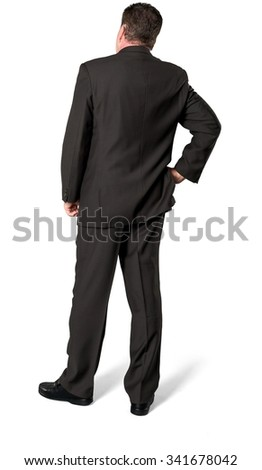 Serious Caucasian elderly man with short medium brown hair in business formal outfit with hands on hips - Isolated