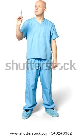 Serious Caucasian man in uniform holding syringe - Isolated - stock photo