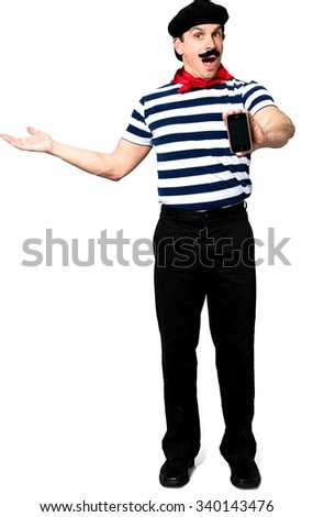 Serious Caucasian man with short black hair in costume holding mobile phone - Isolated - stock photo