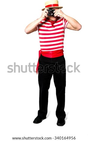 Serious Caucasian man with short black hair in costume using camera - Isolated - stock photo
