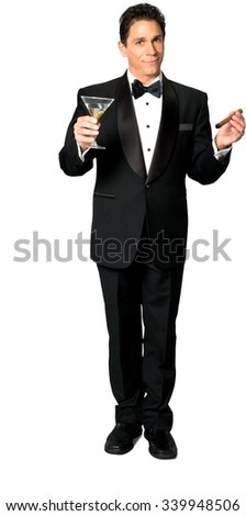 Serious Caucasian man with short black hair in evening outfit using martini glass - Isolated