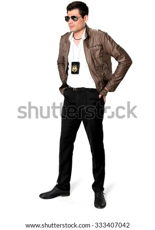 Serious Caucasian man with short dark brown hair in casual outfit with hands on hips - Isolated