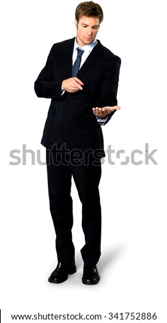 Serious Caucasian man with short medium blond hair in business formal outfit holding invisible object - Isolated