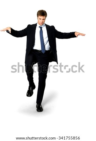 Serious Caucasian man with short medium blond hair in business formal outfit with arms open - Isolated