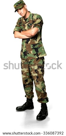 Serious Caucasian Soldier In Green Camouflage Uniform with arms folded - Isolated