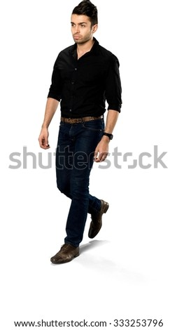 Serious Caucasian with short dark brown hair in casual outfit walking - Isolated