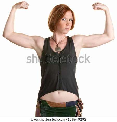Serious Caucasian woman flexing biceps over white background - stock photo