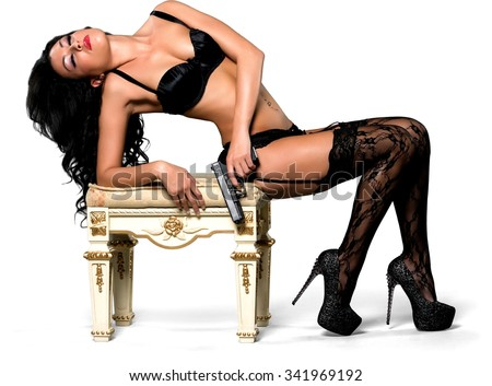 Serious Caucasian woman with long black hair in intimate/nude outfit fashion pose - Isolated - stock photo
