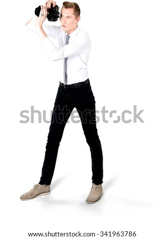 Serious Caucasian young man with short light blond hair in business formal outfit using camera - Isolated - stock photo