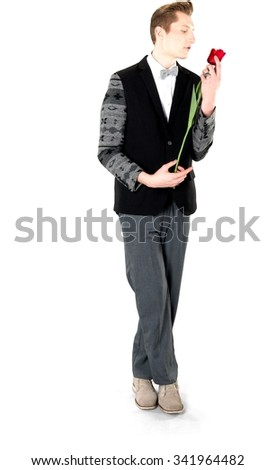 Serious Caucasian young man with short light blond hair in evening outfit holding flower - Isolated
