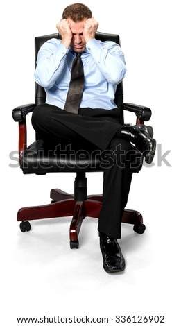 Serious Caucasian young man with short medium brown hair in business formal outfit with hands on face - Isolated