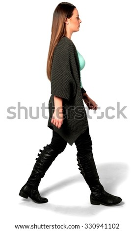 Serious Caucasian young woman with long medium brown hair in casual outfit walking - Isolated