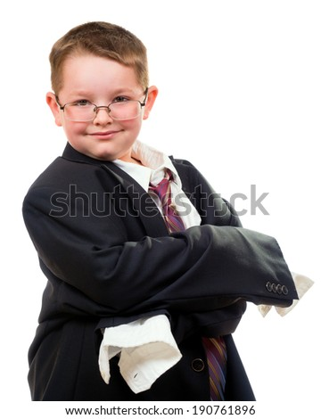 Serious child wearing suit that is too big for him - stock photo