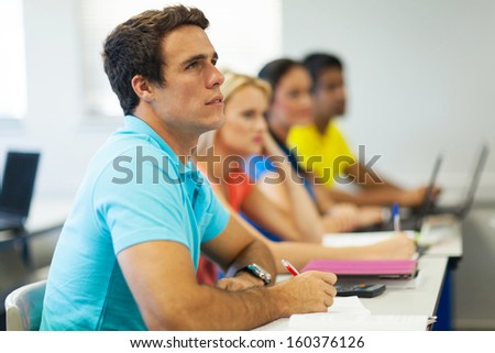 serious college students in class during a lecture