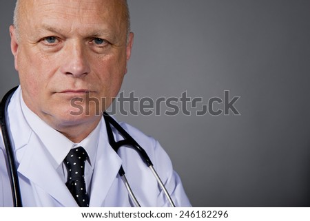Serious Doctor In White Lab Coat - stock photo