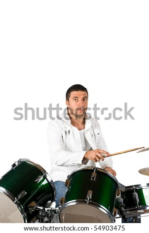 Serious drummer man playing set drums isolated on white background - stock photo