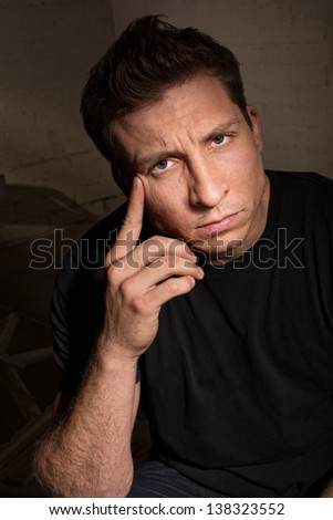 Serious European adult male in black shirt - stock photo