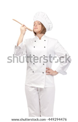 serious female chef, cook or baker with wooden spoon enjoying food isolated on white background. cooking and food concept