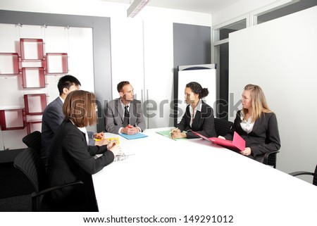Serious group of successful businesspeople on a meeting - stock photo
