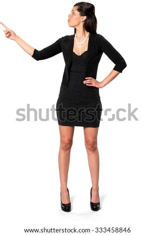 Serious Hispanic young woman with long dark brown hair in casual outfit with hands on hips - Isolated