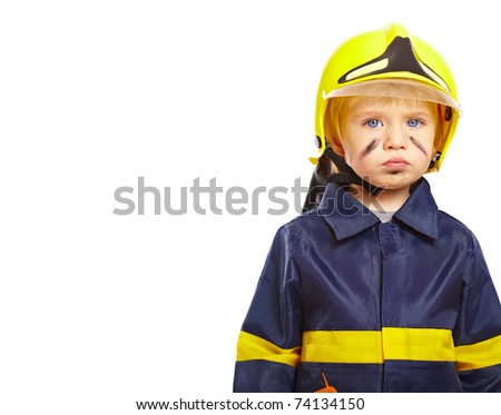 Serious little boy in fireman costume isolated on white background