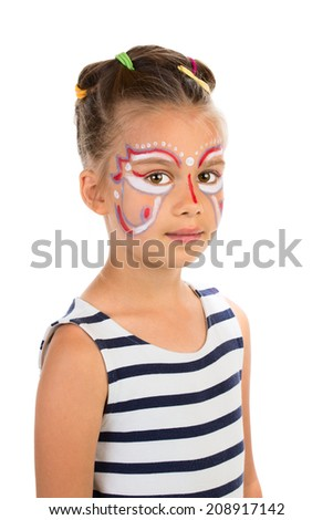 Serious little girl with abstract design paint on her face. Isolated - stock photo