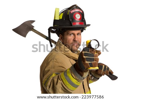 Serious looking confident firefighter standing holding ax and flash light portrait isolated on white background - stock photo