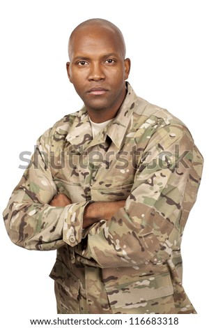 Serious looking serviceman with his arms crossed
