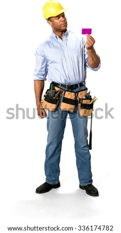 Serious Male Construction Worker with short black hair in uniform holding business card - Isolated - stock photo