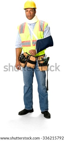 Serious Male Construction Worker with short black hair in uniform using neck brace and having arm in a sling  - Isolated - stock photo