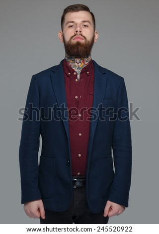 Serious male in blue costume  - stock photo
