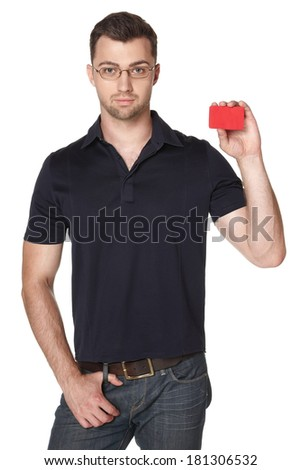 Serious male in eyeglasses showing red card in hand, over white background - stock photo