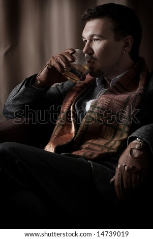 serious man drinking whisky - stock photo