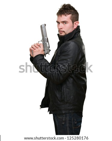 serious man holding a gun against a white background - stock photo