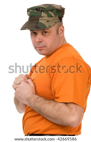 serious man in orange t-shirt on a white background - stock photo
