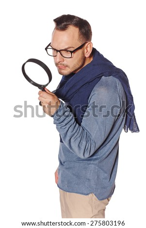 Serious man looking through magnifying glass, over white background. Search concept. - stock photo