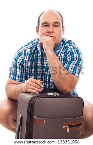 Serious man traveling with luggage, isolated on white background - stock photo