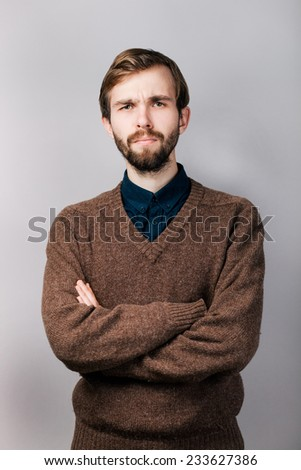 serious man with a beard in brown sweater - stock photo