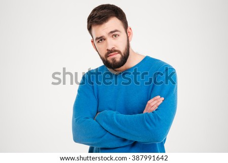 Serious man with arms folded standing isolated on a white background - stock photo