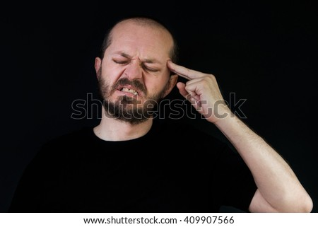 Serious man with beard and mustaches on black background in low key, frustration and despair gesture  - stock photo