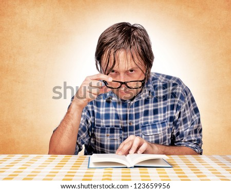 Serious man with the book - stock photo