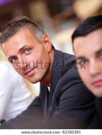 Serious mature businessman in business meeting at office, looking at camera