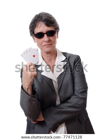 serious mature lady showing four aces isolated on white background - stock photo