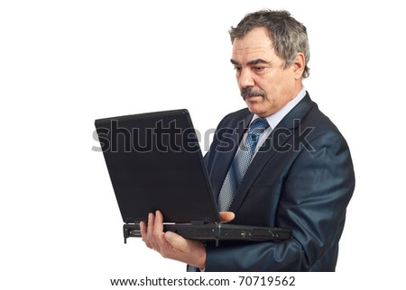 Serious mature manager working on laptop  isolated on white background