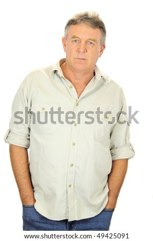 Serious middle aged man standing with hands in pockets. - stock photo