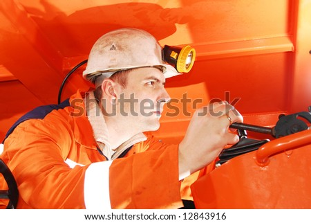 Serious miner working in a mine shaft stock photo
