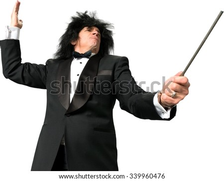 Serious music conductor wearing a tuxedo leading music with baton - Isolated - stock photo