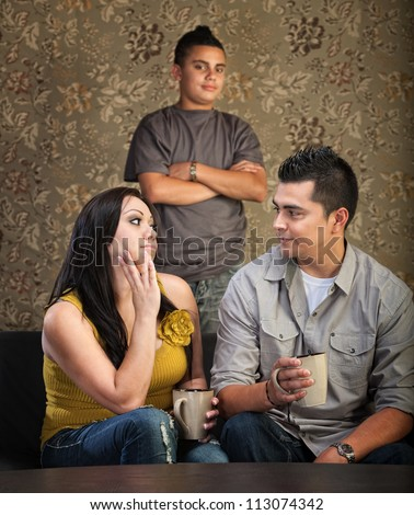Serious Native American mother and father with stubborn son - stock photo